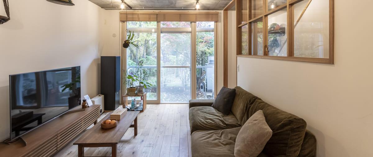 京王永山の中古マンションのリノベーション後のリビングと庭